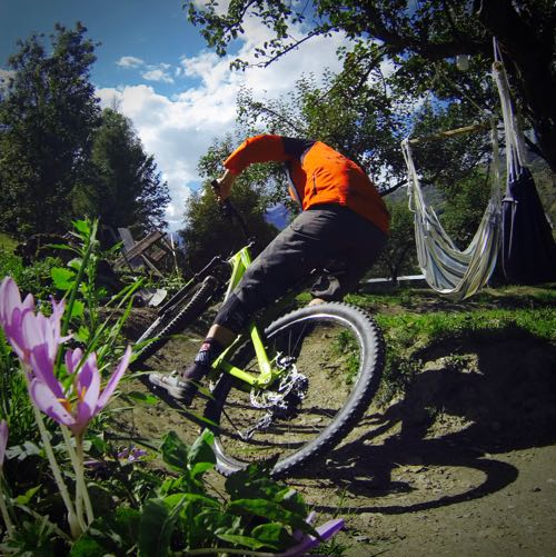 Riding the pump track at the BikeVillage Chalet